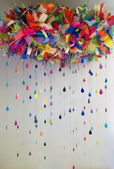 With paper and lace Bonnie Gammill has created this colorful cloud with rain glad any room.-The Crafty Room