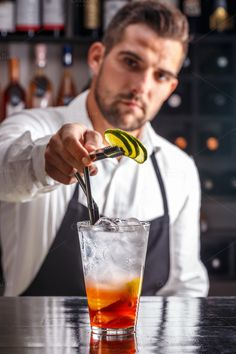 #Barman Barman decorating cocktail with lime
