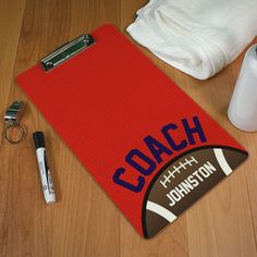 """Personalized Football Coach Clipboards. If his first love is football, then this is just the personalized back to school gift to put a smile on his face. He'll love the fact that his gift is personalized with his name on it, and he'll also be dying to show it off to his friends. Our Football Coach Clipboard is a high gloss .25"""" thick tempered hardboard clipboard. Clipboards are available in Legal or Letter sizes and are sold with a dry erase marker."""