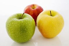 red apple, green apple and yellow apple