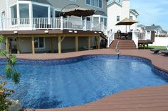Elegant Multi-Level Deck and Freeform Pool: In order to bring the outdoor space up to the same level as the home, our design called for three deck levels leading from the door down to a new freeform vinyl pool. #PoolLandscapingIdeas