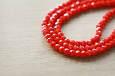 50 pcs of Electroplate Opaque Glass Faceted Plated Red Round Glass - Coral - 3 mm