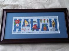 """Completed and framed """"Hawaii"""" cross stitch."""