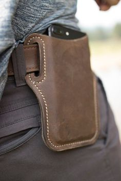 iPhone 8 / 7 / leather holster A handmade iPhone leather holster. I was tired of carrying my iPhone in my pocket and constantly sitting on it. Thus, after several design pattern trials and er Iphone Holster, Leather Holster, Leather Tooling, Leather Wallet, Iphone Leather Case, Leather Totes, Leather Bags, Leather Purses, Pvc Jeans