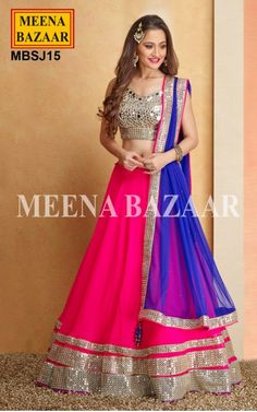 Magenta Georgette Lehenga Choli - Get a Sensational look dressed in this Magenta Net lehenga choli that flaunts grandeur with Glittering Mirror and Zari Work. Comes with Golden matching choli and Royal Blue Net dupatta with similar embellishment as the Lehenga.The Choli is one of those traditional Indian wears which have captivated the minds since time immemorial and this one sure would!. Make a classic addition to your ethnic wear collection and exhibit your grace!