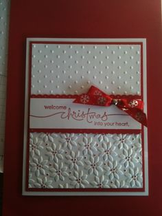 handmade Christmas card ... white with red adornments ... embossing folder textures ... luv how she colored the dots on the small poinsettias ... Stampin' Up!