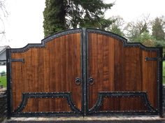 A mix of wood and wrought iron electric gates