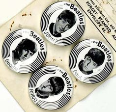 Set of 4 badges, each featuring one of The Beatles