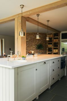 Exposed brick walls, stylish pendant lights and a lovely big island in deVOL's Henley on Thames Kitchen