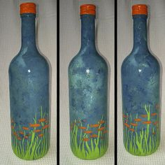 """ORANGE FISH COLONY PASSING BY UNDER THE SEA ON PAINTED BOTTLE    Yello!    This is an entirely hand painted and individually design art on curvy glass bottle, rather tall as well! A very unique and special piece.    Orange Fish Colony Passing by Under the Sea on Painted Bottle    Height, you ask? 32 cm [12.6""""]  Circumference, you shizzle de dizzle?  27 cm [10.6""""]    €30"""