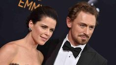 LOS ANGELES, CA - SEPTEMBER 18:  Actors Neve Campbell and JJ Feild arrive at the 68th Annual Primetime Emmy Awards at Microso