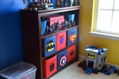 superhero nursery theme | Target canvas bins with DIY superhero felt symbols, superman, batman ...