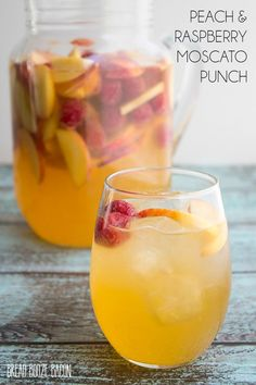 Bring on summer and a never ending pitcher of this Peach & Raspberry Moscato Punch! It's crazy good and made for sipping poolside! #summerbbq