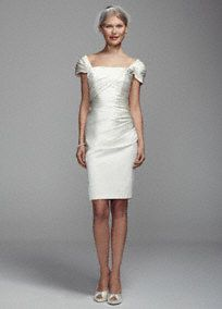 A form fitting wedding dress will surely accentuate all of your best assets on your special day!  This short satin dress features off the shoulder cap sleeves with figure flattering pleating detail and a dazzling pearl and crystal embellishment on one strap.  Available in Ivory.  Fully lined. Imported. Back zip. Dry clean only.  To protect your dress, try our Non Woven Garment Bag.
