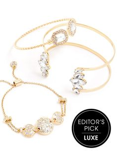 This stack proves that a little sparkle goes a long way.  Consisting of stacked gold wristwear, each piece is covered in a fresh coat of crystals for a look that really pops.