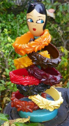 Bakelite Carved Bracelets - 8- Flowers - Vintage & Rare>>> Pinned not just for the brackets but the display paper towel holder.