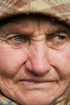 Chernobyl. Nastasya Vasilyeva, 67, cries next to her house in the village of Rudniya, just outside the Chernobyl exclusion zone. Recently Vasilyeva was diagnosed with a cancer.
