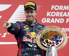 Sebastian Vettel salutes his team on the podium #Korea2013
