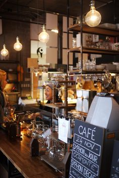 Café Falco | Montreal. Very warm woods/hues. Feels turn-of-the-century pharmacy almost.