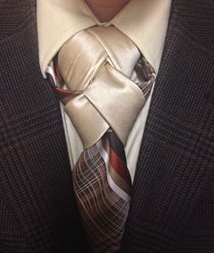 I really like how the patterned tie appears to split in the tie knot, being anchored in place by the solid necktie.