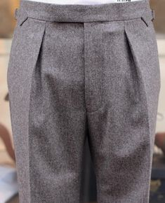 Extended waistband with hidden clasp closure