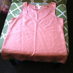 JCrew tank top 100% silk J Crew tank top. Great for jeans or skirt tucked in or left out. Pair with Blazer and cute sandals and set. It's peachy not really orange but peach isn't an option Lol. J. Crew Tops Tank Tops