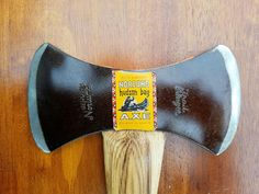In very near mint condition with original leather sheath. Sharp edge and does not appear to have ever been used. Original brown lacquer on head. Original stickers. Only blemishes on sheath are a slight discoloration in upper right corner of the front, and minor discoloration of the top edge on the back of the sheath, they appear to be slight water marks.