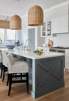 Hamptons style kitchen with duck blue kitchen island, white benches and large rattan pendant lights. Chrome tapware. In Southern Hamptons cottage home. #kitchendesign #hamptonstyle #hamptonskitchen #rattanpendants #whiteandbluekitchen #stripedbarstools Hamptons Kitchen, Hamptons House, The Hamptons, Modern Country Kitchens, Farmhouse Style Kitchen, Home Kitchens, Kitchen Island Bench, Large Kitchen Island, Large Kitchens With Islands