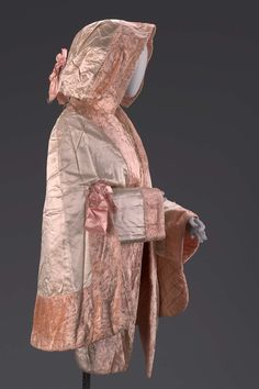 Woman's fur cape 1840–49 Woman's cape of cream silk satin trimmed with pink silk plush with separate, matching hood and sleeves.