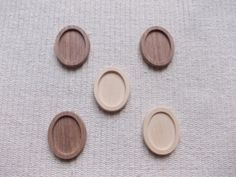 Mix of 5 pieces unfinished oval dark walnut/ ash wood/cherry jewel base/frame for jewel making. It is perfect size to make brooch, pins or pendant. You can use it as a photo picture frame, too. The edges are slightly polished. This product supplied unpainted so you can paint it in any colour you want. With this jewel base you can make different kinds of jewels: you can put a nice miniature picture or a needlework in it, or to use it for resin artwork.