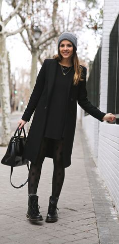 Winter Outfits We'd Wear: Natalia Cabezas is wearing a black dress and coat from