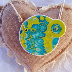 annesophie-b: septembre 2014 Polymer clay mokume gane pendant with front button closure
