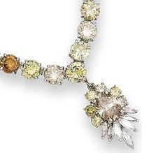 The necklace designed as a series of graduating brilliant-cut diamonds of various tints, suspending a detachable diamond cluster pendant highlighted with a spray of marquise-cut stones, the pair of diamond earstuds of brown tint, diamonds in necklace approximately 27.00 carats total, diamonds in earstuds approximately 1.80 carats total, diamonds untested for natural colour.