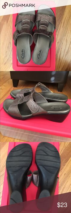 Clarks genuine leather sandals. Wore them several times and still in pretty good shape. There is an adjustable Velcro strap on the bottom strap. The color is pewter. Nice neutral to match many outfits. Clarks Shoes Sandals