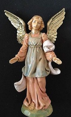 This item is the beautifully sculpted and decorated standing angel. Fontanini Nativity, Garden Sculpture, Sculpting, Disney Characters, Fictional Characters, Angel, Statue, Disney Princess, Decor