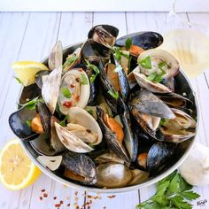 Clams and Mussels in Garlic Butter Wine Sauce is so full of flavor. On its own, or served over Bucatini, you'll want to make this over and over again.
