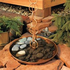 Use these DIY rain chains...  http://www.homesteadingfreedom.com/11-awesome-rain-chain-ideas-with-tutorials/