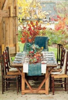 Fall table: teal accents play off natural orange leaf decor