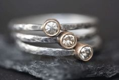 http://alexisrussell.com/collections/rings/products/natural-silver-clear-diamond-stacking-ring-14kt