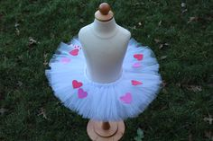 A personal favorite from my Etsy shop https://www.etsy.com/listing/262462053/hearts-a-plenty-tutu-white-valentines