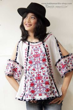 Batik Amarillis made in Indonesia www.batikamarillis-shop.com - Batik Amarillis's Breezy no 4 (wiith Ukrainian  beautiful embroidery inspired)it's gorgeous top with unique hanging cut out sleeves, pair it with your fave's jeans and you're ready for some actions!