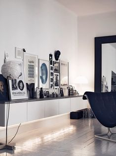 Wall of frames, layered candles and vases in front | Recreate in your home with BESTÅ wall cabinets