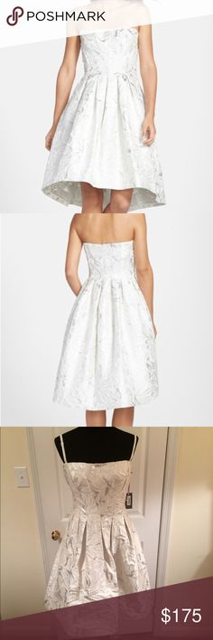 """NWT Vera Wang Jacquard Fit & Flair Dress NWT Vera Wang Jacquard Fit & Flair Dress. Shimmery floral jacquard instantly elevates a crisp, breathtaking dress in a classic fit-and-flare silhouette. Remove the adjustable spaghetti straps for a versatile strapless style that stays perfectly poised with a fitted corset bodice. Length = 30"""" bust = 38"""" Back zip closure. Lined. Shell = 56% polyester, 44% metallic fibers. Lining = 100% polyester  Vera Wang Dresses"""