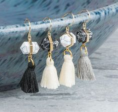 Earrings with white or black stones have been paired with cream, black or gray tassels to make an amazing pair.