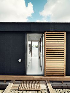 come_home_to_high_water-copehagen-floating-home-larch-wood-shutters-entrance