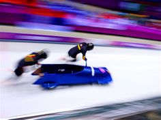 Sochi 2014 Day 10 - Bobsleigh Two-man Heat Pilot Nicolae Istrate and Florin Craciun of Romania team 1 make a run during the Men's Two-Man Bobsleigh heats on Day 10 of the Sochi 2014 Winter Olympics at Sliding Center Sanki