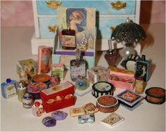 An assortment of vintage perfumes,soaps, sachets and cosmetics. Nothing but some spare beads,a little glue, a little paper and again the wonders of photoshop. =)