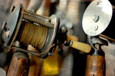"""Item Description: Original Photograph, by Joan Schulte, entitled, """"Rod."""" This is a beautifully composed, abstract image of an antique fishing rod and reel. The fishing theme, along with its warm wood tones, creates a feeling nostalgia and would be a comforting, thought provoking conversation piece in a home study or in the workplace office of a fisherman. This piece is a hand-transferred photograph that has been applied onto a hand-crafted, 5.5""""x8.25""""X1.5"""" rectangular box panel (or support)…"""
