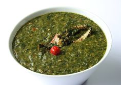 Callaloo, Antigua. Hailed as a taste of the Caribbean, this soup is made with callaloo or spinach leaves blended with spicy peppers, cloves and other seasonings. Similar to a stew but often served as a soup side dish or as a gravy with crab.
