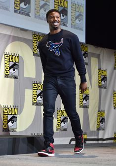 Michael B. Jordan wearing Nike Air Jordan 1 High The Return 'Bred' Sneakers,  Coach F/W 16 Dinosaur Sweatshirt